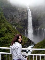 Devin Sugameli '08 standing in front of waterfalls at Nikko