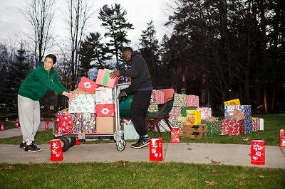 Soccer players Derrick Yam '17 and Adebare Oyeniyi '17 cart up food and supplies.