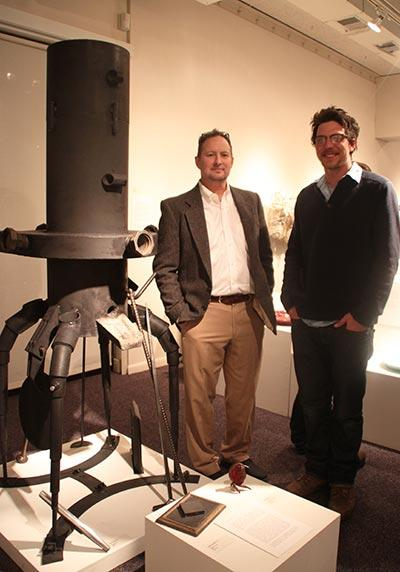 Professor John Galt and alum Charlie Engelman with the cupola furnace they built. Galt writes, 'Throughout history, metal casting has played a significant role in the development of art, science, and culture. It continues to be a primary way sculptors realize their work.... This cupola furnace was designed and built by a student / faculty team at Skidmore, and is used by students to create tools and works of art.'