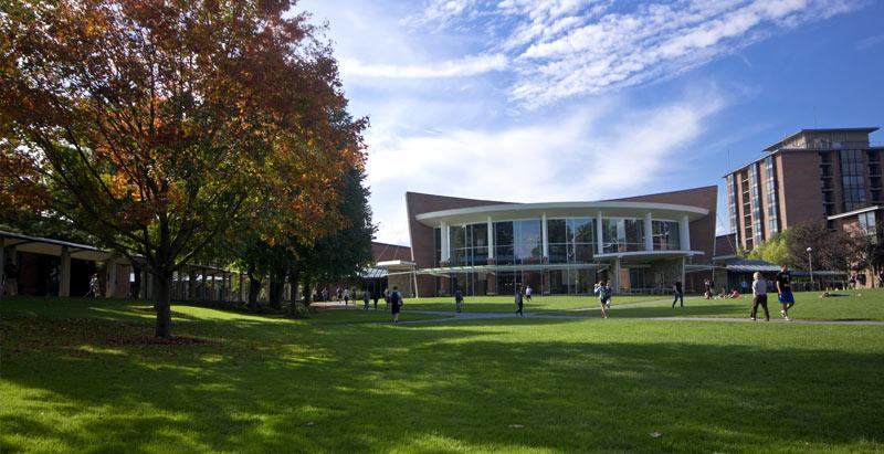 A view of the campus green with the iconic Murray-Aikins Dining Hall in the background.