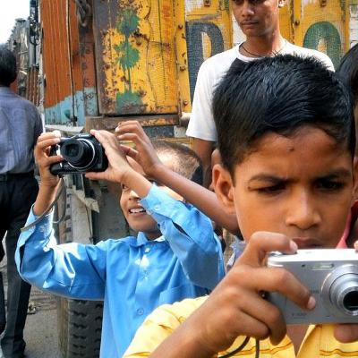 "For the theme ""Okhla from New Angles,"" fifth-grader Deepak took this picture of classmates Ashish and Akash, as a curious local resident looked on."