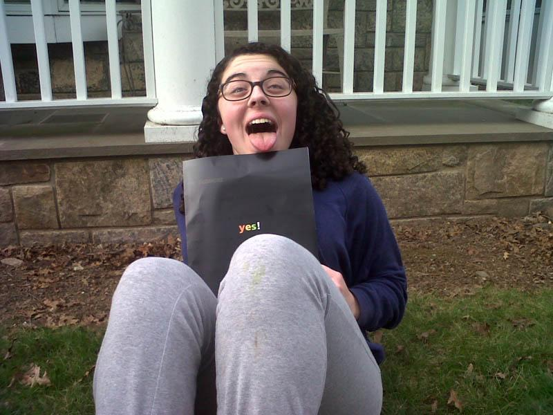 Julia%20Rutkovsky%20%2716%20poses%20with%20her%20Skidmore%20College%20acceptance%20packet.%20