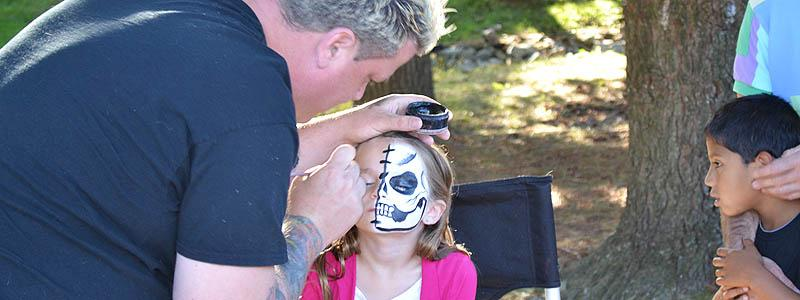 Facepainting at the Greenberg 25th Anniversary picnic