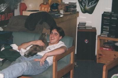 Jeremy Patuto '98 with Charlotte the cat. Submitted by Joe Jolly '98.