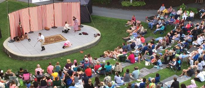 Members of the Skidmore and Saratoga community gather in the amphitheater to watch a Shakespeare performance.