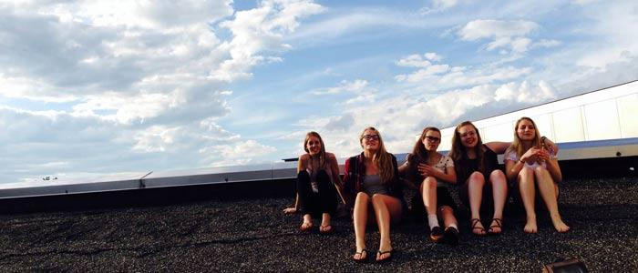 Students at the NYS Summer Young Writers Institute find inspiration on the roof of the Tang Museum.