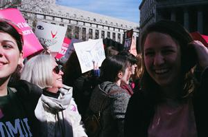 Jenna Borden '12, Prof. Mary Stange, and Olivia Morrow '12 rally at Foley Square.