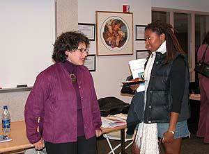 Skidmore alumna Helene Schneider '92 speaks with Women's Studies major Jessyca Dudley '06 after the 'Living the Liberal Arts' panel (Oct. 2005)