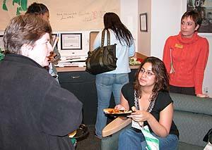 Professor Kate Berheide speaks with alumna Ivonne Salazar '04 while Donna Marino of Career Services looks on. ('Living the Liberal Arts' panel, Oct. 2005)