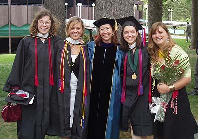 Graduation 2005, at SPAC. From left to right: Ashley Goldsmith, Mikki Pugh, Professor Adrienne Zuerner, Program Director, Leah Goldberg, Stephanie Drahan.  Photo courtesy of Stephanie Drahan '05