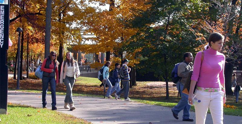 Students walk across campus to classes.