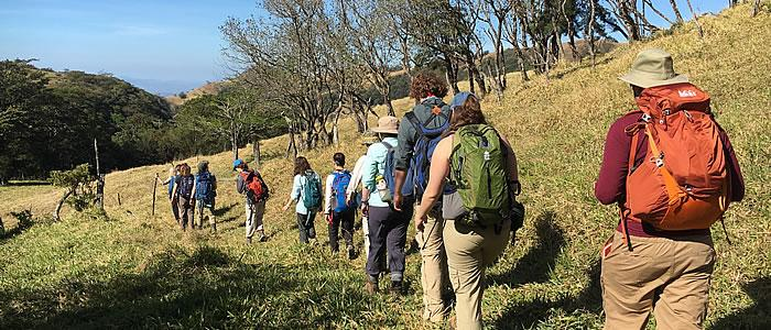 Students heading to a reforestation plot to monitor tree growth; Travel Seminar: Tropical Field Ecology & Conservation in Costa Rica.