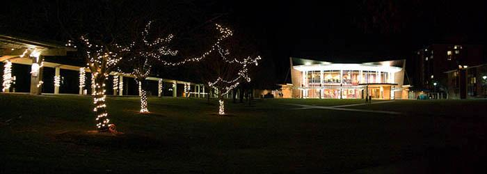 Holiday lights on the quad, with Murray-Aikins Dining Hall to the right.