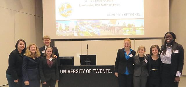 The Skidmore EUROSIM delegation at the podium at the University of Twente.