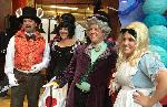 ...to be greeted by the White Rabbit (Patrick Girard), the Queen of Hearts (Bonnie Bertrand), the Mad Hatter (Mark Miller), and Alice (Kyleigh Lanzone).