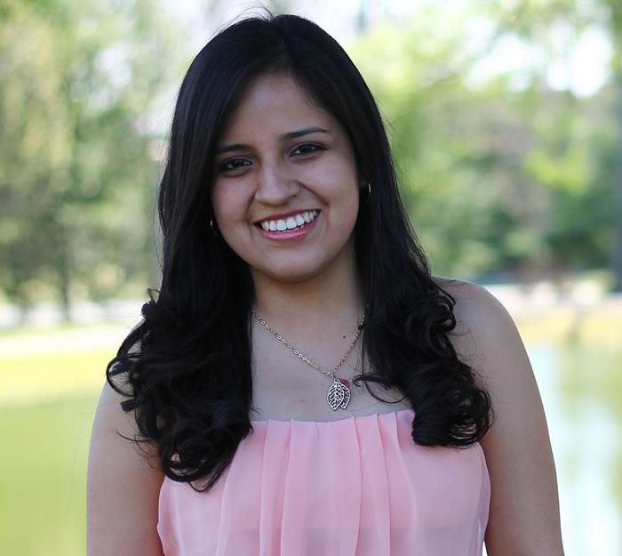 Michelle Mendia '14, a Psychology major and Spanish minor, is helping Ecuadorians transition to the US through Organizacion Juventud Ecuatoriana (JUVE) in New York City.