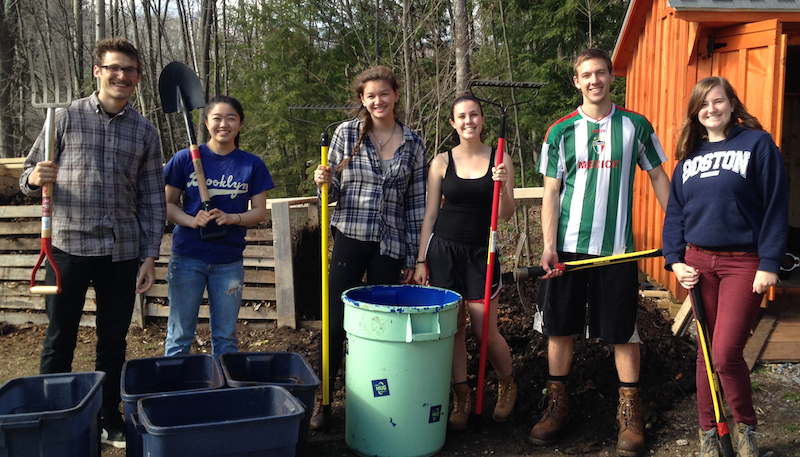 Students collect food waste from apartments for the campus composting program each week.