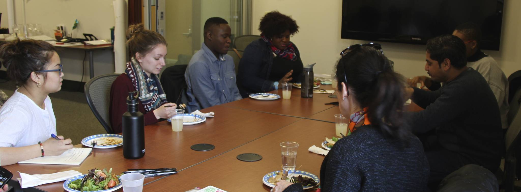 YouthFX at lunch with Skidmore students