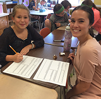 Fifth-grader Carly Fay works with Skidmore's Meghan Wojtkiewicz '16.