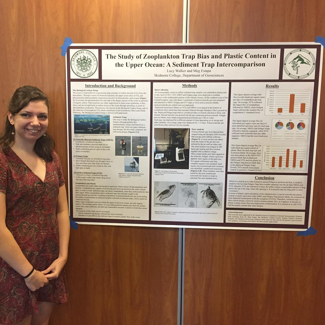 Lucy Walker '19 stands with her poster describing her summer research project with professor Meg Estapa