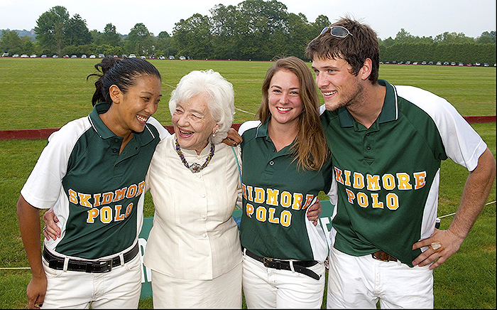 Anne Palamountain with Skidmore Polo players at the annual polo benefit.