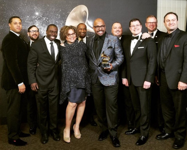 Christian McBride Band at the Grammy awards: McBride is holding the Grammy; Michael Dease is to the right of McBride, and James Burton III is at far left. (Steve Davis and Brandon Lee not pictured.)