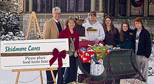 President Glotzbach and Marie Glotzbach with student volunteers for Skidmore Cares, along with some of the donations received.