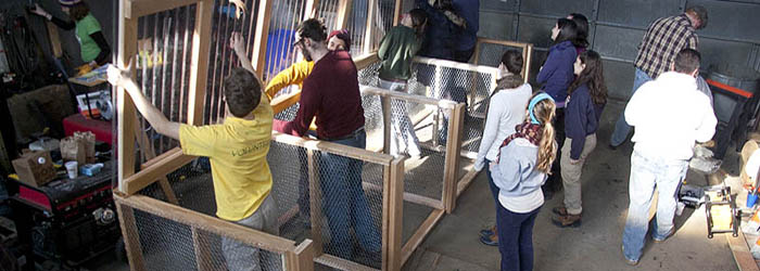 Students work to build a composting facility.