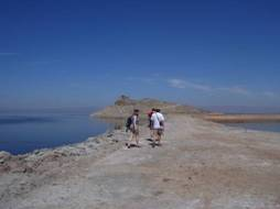 Kim Marsella, Bob Turner and Michael Ennis-McMillan walking along the shore of the Salton Sea