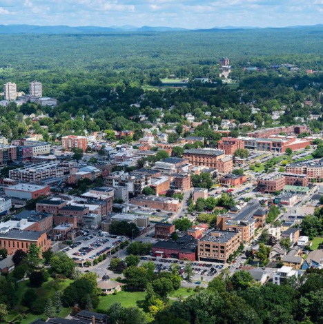 Aerial view of downtown Saratoga Springs with Skidmore's campus in the background.
