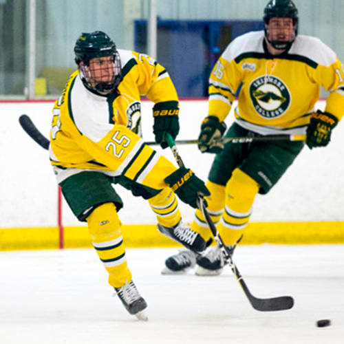 two Skidmore hockey players passing the puck