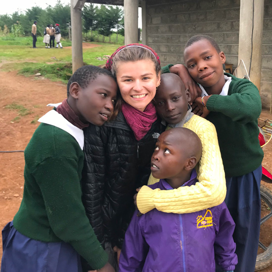 Marley+Amico+poses+with+school+children+in+Kenya