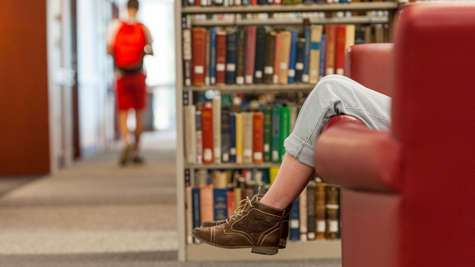 Student studies in the library
