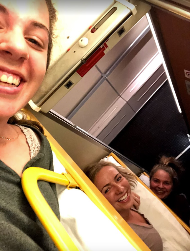 Skidmore students in triple bunk beds on a train in Europe