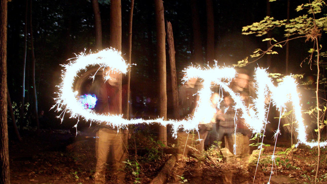 Time lapse image capturing the letters C, T, M spelled out by sparklers