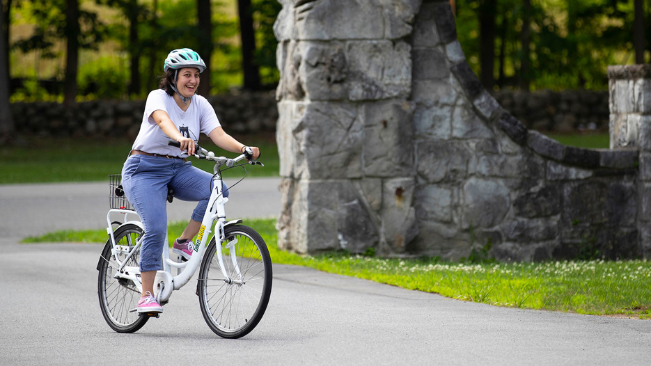 Hadia Bakkar with a bike at Skidmore College