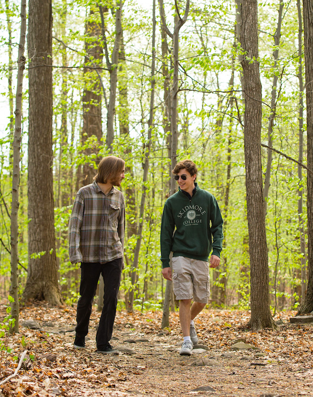 College students hike in Skidmore's North Woods