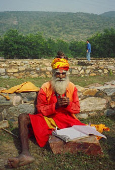 Hindu Saddhu sketching at the old temple grounds of a Buddhist site in Rajasthan. Photo by Hunter Marston, '07