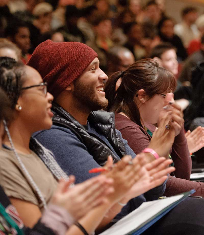 Students and staff enjoying auditorium lecture