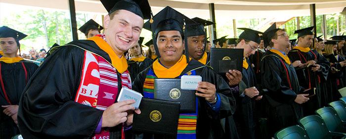 Diplomas in hand