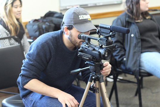 Student working with video camera