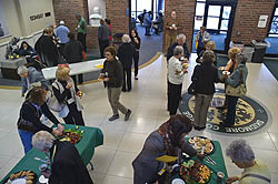 Participants in the Mature Learners Lecture Series arrive in the Palamountain/Dana lobby for pre-lecture refreshments. (Photo by Erick Jenks)