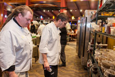 chefs study ingredients for competition