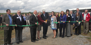Dignitaries cut ribbon at solar celebration