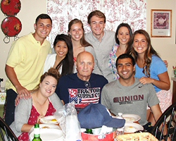 Students help a care-home resident celebrate his birthday