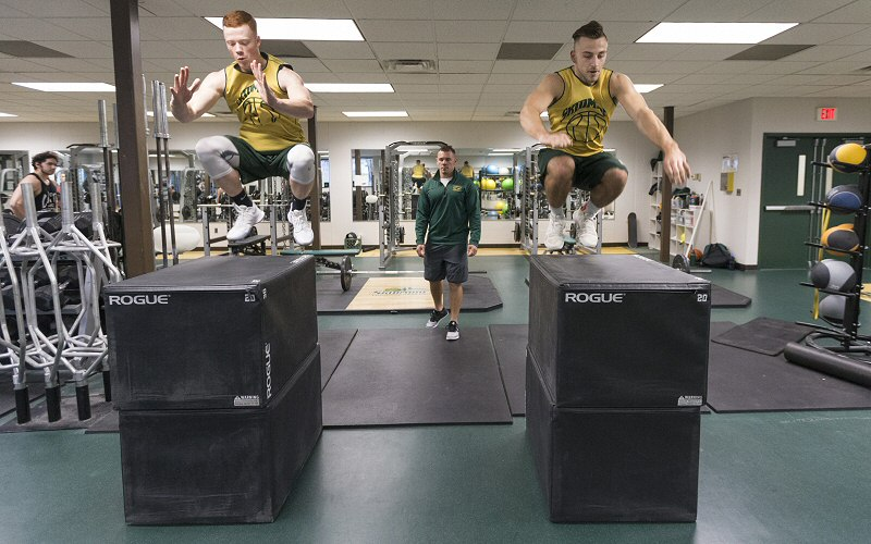 Sophomore Pat Gallagher '20 and Ed Rupkus '19 make prodigious leaps under the guidance of Matt Chatham, strength and conditioning coach for all T'bred teams.