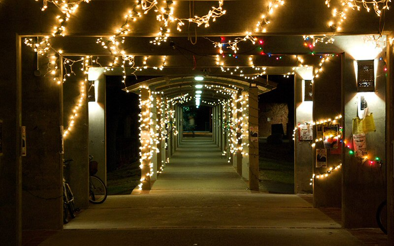 Before the break, covered walkways along Case Green are festooned with holiday lights.