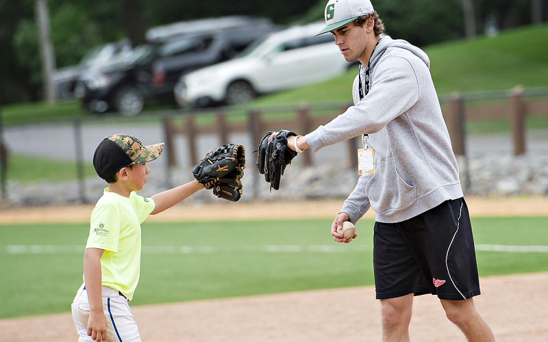 Also a T'bred hockey player, Tim Allen '20 role-models some team spirit; this is his first summer of helping teach Skidmore's baseball clinic.