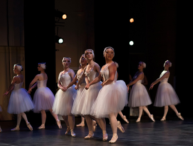Students dance in a ballet performance of Swan Lake