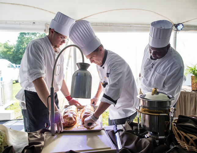 Skidmore College chefs work at a carving station